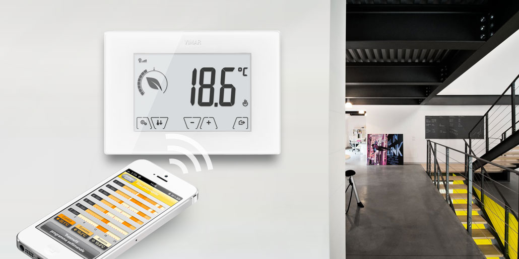 Wifi thermostat with Ecometer for energy efficient heating with large high-contrast lcd display for best readability in crystal white housing Esthetics and Interaction designed by quickpartners. in contemporary design villa