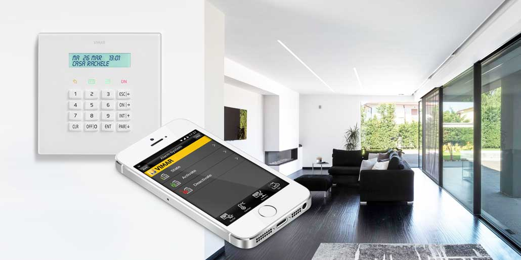 Vimar By-Phone App for remote control of automated homes with SMS and GSM cellphones and smartphones. Activation of Bimar alarm system By-Alarm in white elegant modern villa