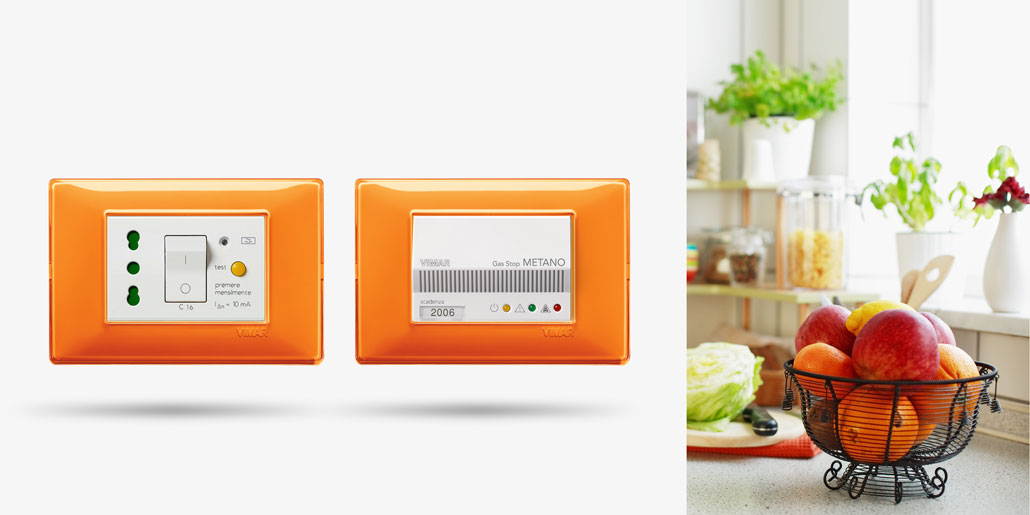 Vimar Plana switch range design by quickpartners+ with many comfort and security functions as life saving switches and gas sensors in innovative design frame reflex orange in kitchen with fruits