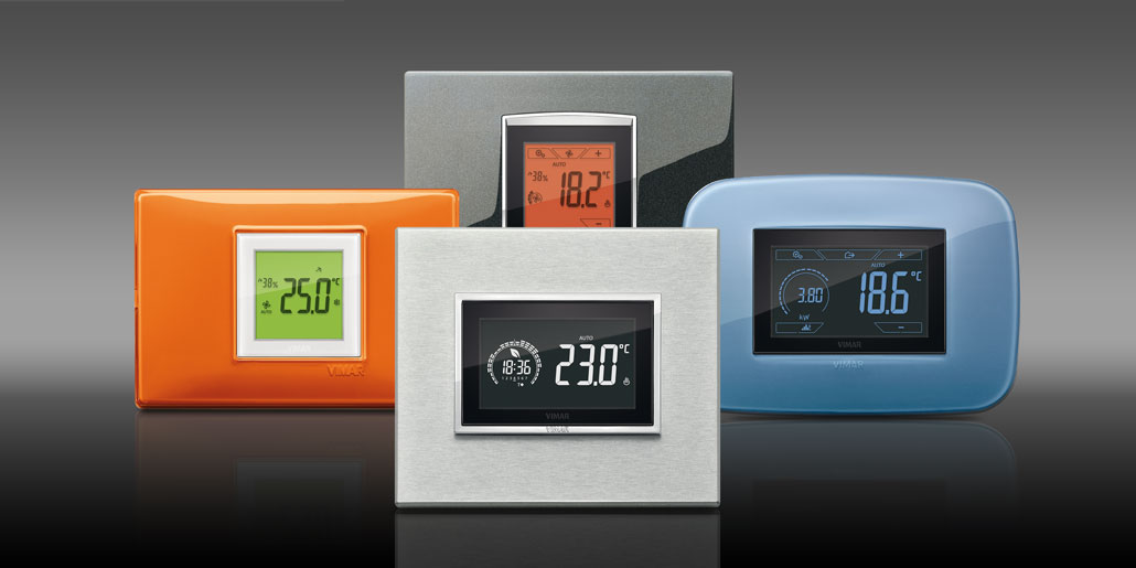 Thermostats Clima & Energy for decorative frames of series Evo black , Eikon Aluminium, Arke Reflex glue and Plana Reflex orange . Comfort and energy efficiency combined with precious design and perfect readability from distance. Multicolor display adapts to characteristic color of each series. Programmable with By clima app with audio connection. Perfect User experience in all aspects.
