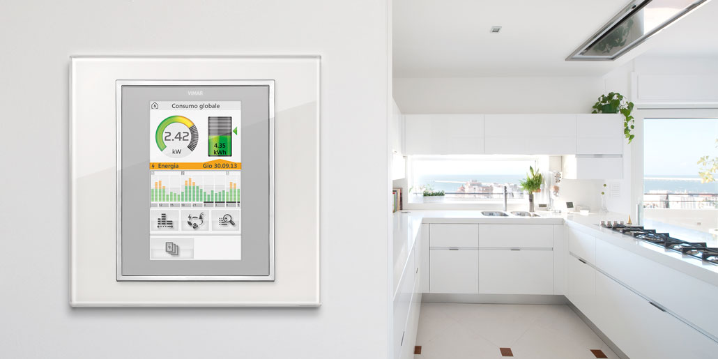 The comfortable and natural way to communicate with automated homes - Touchpanels Vimar Byme designed by quickpartners with energy monitor for making energy saving easy. Eikon full flat in white kitchen